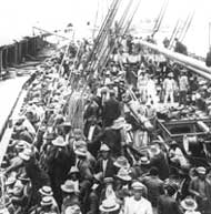 A steamer carrying labourers from Barbados arrives at Colón